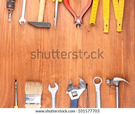 Instruments on wooden background #101577703