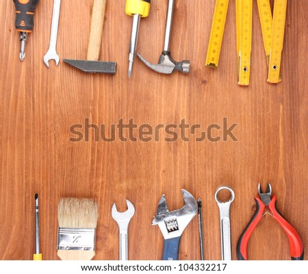 Instruments on wooden background #104332217