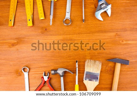 Instruments on wooden background #106709099