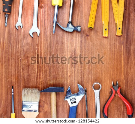 Instruments on wooden background #128154422