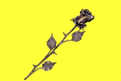 Insulated cast-iron rose on a light yellow background.