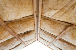 Insulation of attic with fiberglass cold barrier and insulation material
