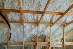 Insulation of attic with foam polyurea insulation cold barrier and insulation material