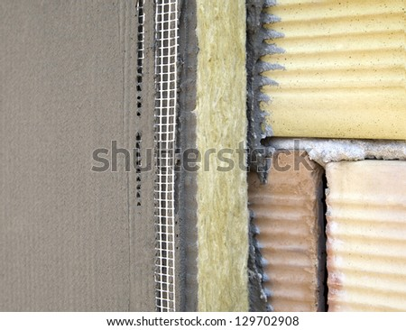Insulation on a brick wall with mineral wool and glue for Mineral wool wall insulation