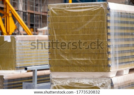 Insulation sandwich panels at the construction site. Fiber material for warming the walls of the building.