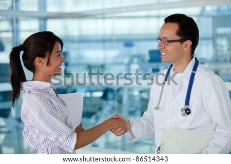 Insurance agent handshaking with a doctor making business