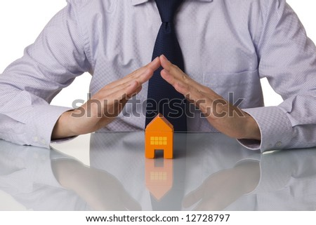 Insurance agent showing houses, isolated with reflection