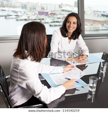 Insurance agent with client in a nice office