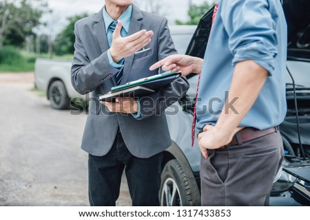 Insurance agent working claim process in payment on from parties. Insurance agent examine damaged car and customer checking on report claim form after accident, Accident and insurance claim concept.