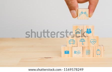 insurance concept, hand man try to put the insurance to protect or cover person, Property ,Liability, reliability,car, life, business, health, house, legal expenses, travel