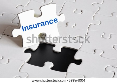 insurance concept with white puzzle or jigsaw