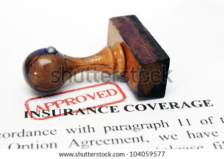 Insurance coverage and wooden stamp