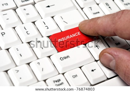 Insurance key pressed by male hand