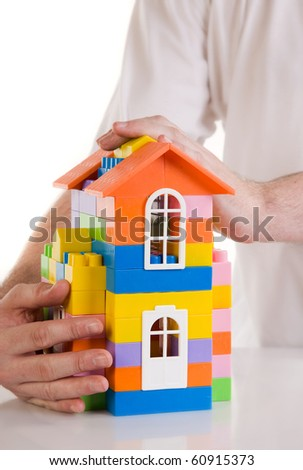 Insurance of the real estate. Toy house model on a white background