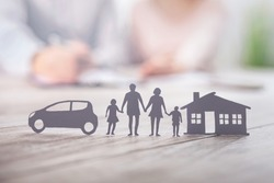 Insurance protecting family health live, house and car concept. Cut elements from paper that symbolize the coverage.