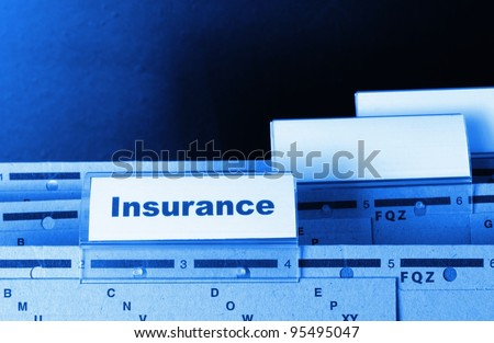 insurance word on business folder showing risk management concept