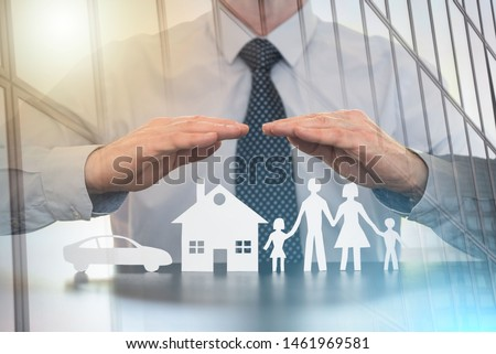 Insurer protecting a family, a house and a car with his hands; multiple exposure