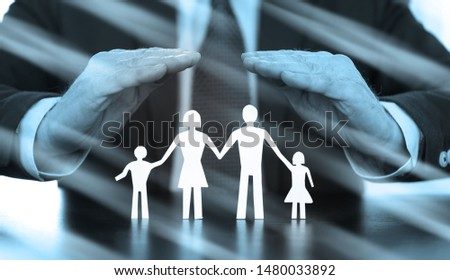 Insurer protecting a family with his hands, black and white; multiple exposure
