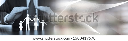 Insurer protecting a family with his hands, black and white. panoramic banner