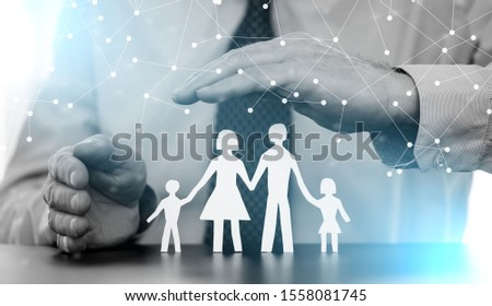 Insurer protecting a family with his hands; multiple exposure