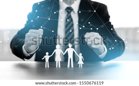 Insurer protecting family with his hands; multiple exposure