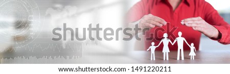 Insurer protecting family with his hands; panoramic banner