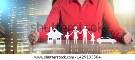 Insurer protecting house, family and car with his hands; multiple exposure #1429193504