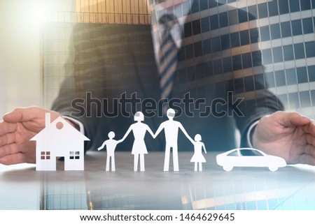 Insurer protecting house, family and car with his hands; multiple exposure