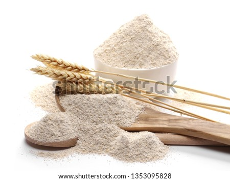Integral barley flour and wheat ears with wooden spoon and bowl isolated on white background Foto d'archivio ©