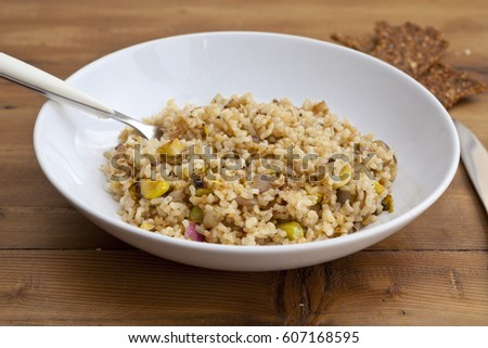 Shutterstock integral rice with vegetables dish in a wooden background with crackers and lemonade