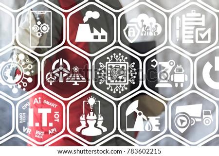 Integrate Industry 4.0 Smartphone concept. Industrial engineer using virtual interface offers smartphone cogwheels mechanism icon. #783602215