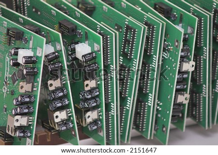 Integrated Circuits - 3 - stacked on a table. - stock photo