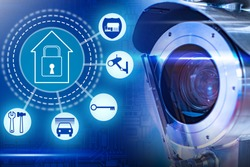 Integrated video surveillance system. Security symbol next to CCTV camera. Concept is the installation of CCTV cameras in house and house. Sale and service of video surveillance systems.