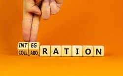 Integration or collaboration symbol. Businessman turns cubes, changes words 'collaboration' to 'integration'. Beautiful orange background. Business, integration or collaboration concept. Copy space.