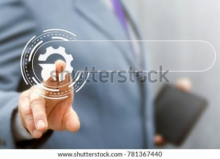 Integration Web Search Information Technology Template concept. Businessman using virtual modern touchscreen presses cogwheel arrow button. Integrate Internet Service.
