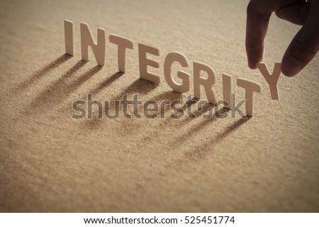 INTEGRITY wood word on compressed board with human's finger at Y letter Stock photo ©
