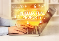 INTELLECTUAL PROPERTY inscription on laptop, internet security and data protection concept, blockchain and cybersecurity