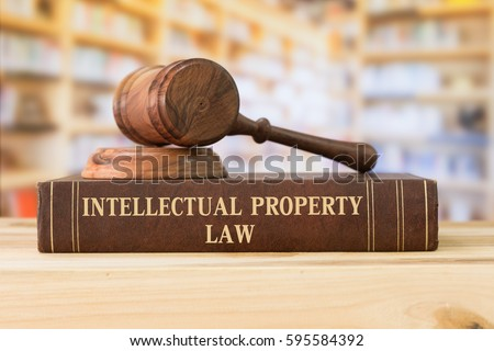 Intellectual Property law books and a gavel on desk in the library. concept of legal education.