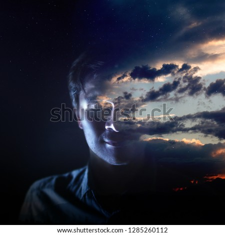 Intelligence and psychology, the concept of the inner world of man. Meditation, silhouette of a man and the sky with clouds, double exposure
