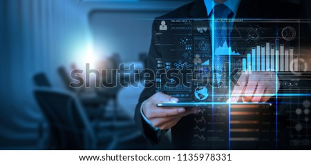 Intelligence (BI) and business analytics (BA) with key performance indicators (KPI) dashboard concept.Website designer working digital tablet and smart phone.