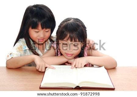 Intelligent little asian girl  reading a book