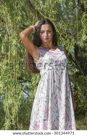 Intelligent woman against the backdrop of nature rests