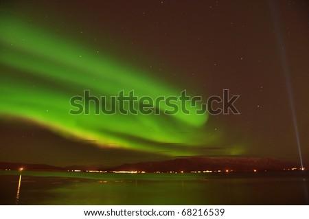Intense Aurora borealis (northern lights)  and lots of stars, Iceland
