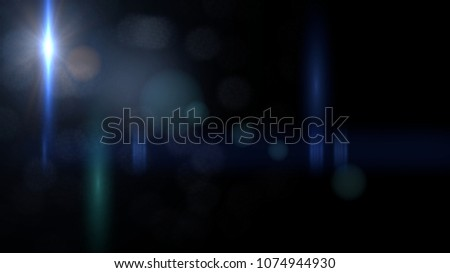 intense blue lens flare overlay texture with bokeh effect with black stage background #1074944930