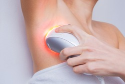 Intense pulsed light or laser armpit depilation and unwanted hair removal. Spa treatments at home, concept image