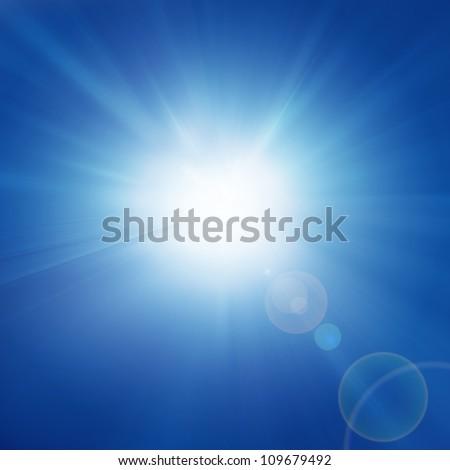 Intense sun on a soft blue background