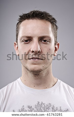 Intense young man poses for a portrait