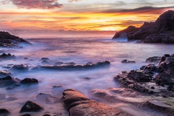 Intensely colorful sunrise at Halona Cove, commonly known as Eternity Beach, on Oahu, Hawaii