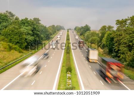 intensive traffic on the German motorway in the morning, fog
