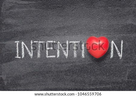 intention word handwritten on chalkboard with red heart symbol instead of O